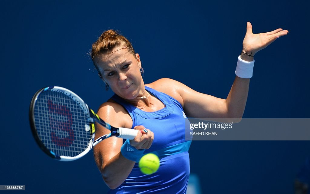 Anastasia Pavlyuchenkova of Russia returns to Agnieszka Radwanska of Poland during their women's singles match on day six of the 2014 Australian Open tennis tournament in Melbourne on January 18, 2014.
