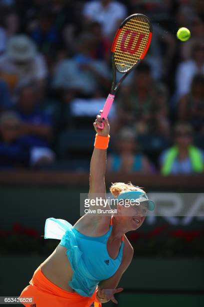 Anastasia Pavlyuchenkova of Russia serves against Dominika Cibulkova of Slovakia in their fourth round match during day nine of the BNP Paribas Open...