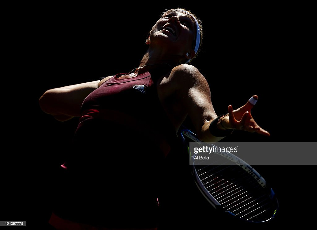 Anastasia Pavlyuchenkova of Russia serves against Nicole Gibbs of the United States on Day Four of the 2014 US Open at the USTA Billie Jean King National Tennis Center on August 28, 2014 in the Flushing neighborhood of the Queens borough of New York City.