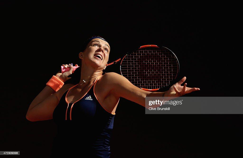 Anastasia Pavlyuchenkova of Russia serves against Petra Kvitova of the Czech Republic in their third round match during day five of the Mutua Madrid...