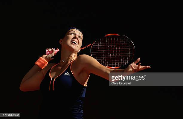 Anastasia Pavlyuchenkova of Russia serves against Petra Kvitova of the Czech Republic in their third round match during day five of the Mutua Madrid...