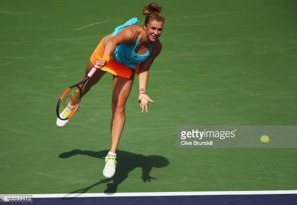 Anastasia Pavlyuchenkova of Russia serves against Svetlana Kuznetsova of Russia in the quarter final match during day ten of the BNP Paribas Open at...