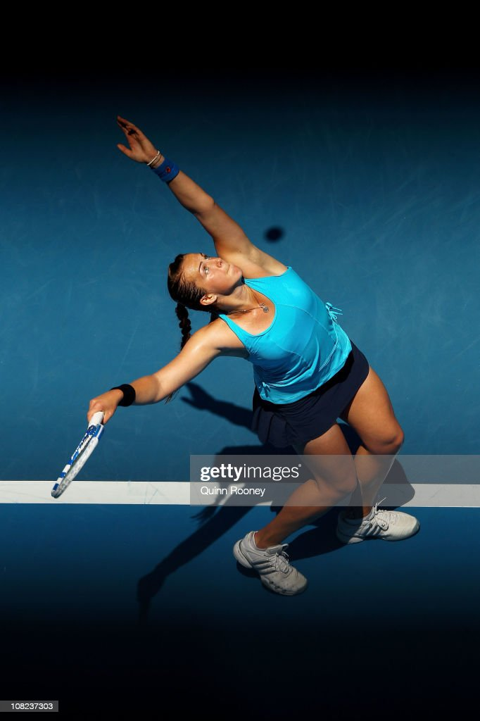 Anastasia Pavlyuchenkova of Russia serves in her third round match against Iveta Benesova of the Czech Republic during day six of the 2011 Australian...