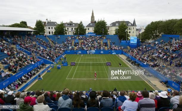 Anastasia Pavlyuchenkova of Russia serves to Agnieszka Radwanska of Poland during their womens singles first round match on the third day of the...