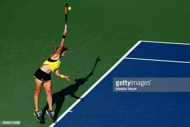 Anastasia Pavlyuchenkova of Russia serves to Carla Suarez Navarro of Spain during their match on Day 6 of the Connecticut Open at Connecticut Tennis...