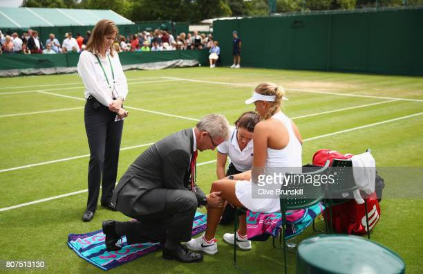 Anastasia Potapova of Russia receives treatment during the Ladies Singles first round match against Tatjana Maria of Germany on day two of the...