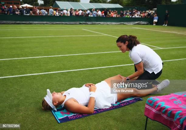 Anastasia Potapova of Russia receives treatment from the medical team during the Ladies Singles first round match against Tatjana Maria of Germany on...
