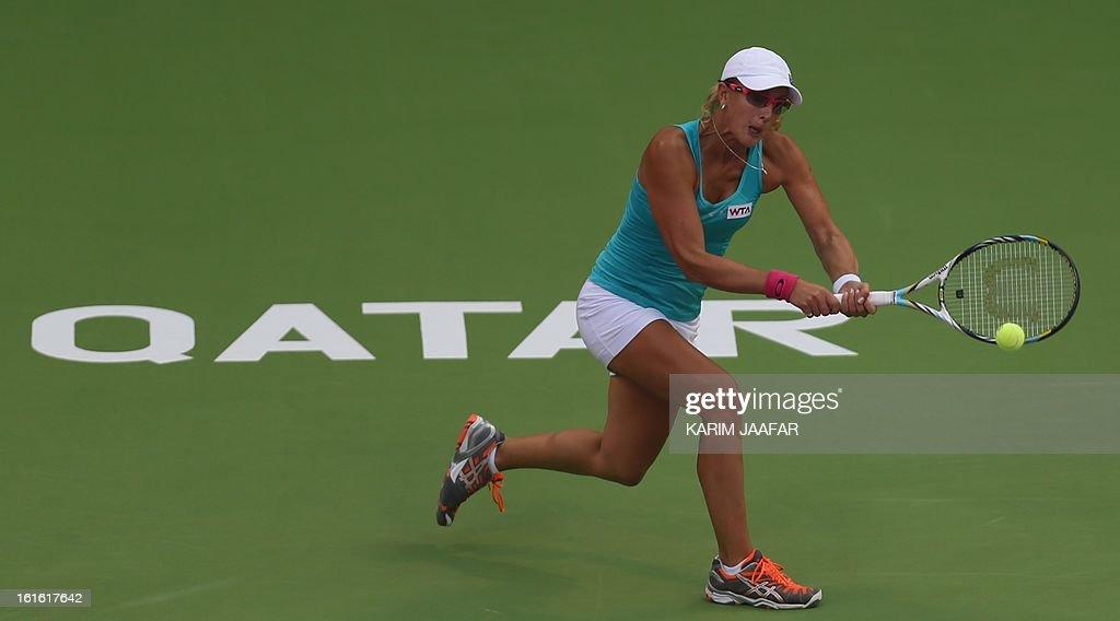 Anastasia Rodionova of Australia hits a return to Agnieszka Radwanska of Poland during their WTA Qatar Open tennis match on February 13, 2013 in the Qatari capital Doha.