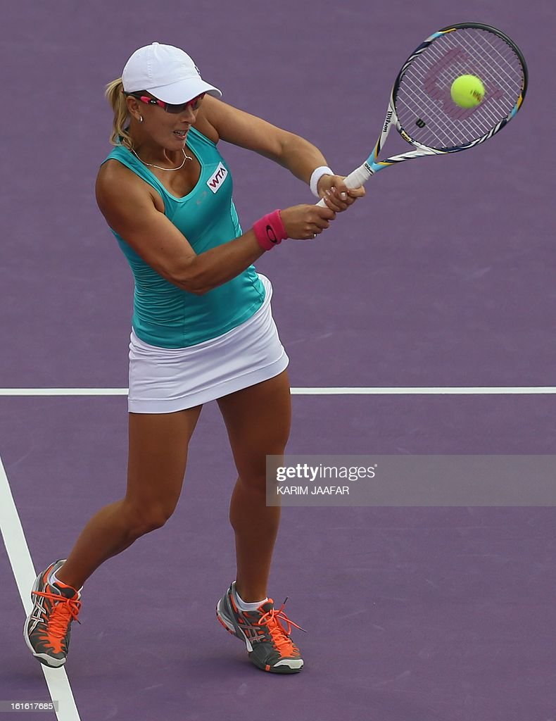 Anastasia Rodionova of Australia hits a return to Agnieszka Radwanska of Poland during their WTA Qatar Open tennis match on February 13, 2013 in the Qatari capital Doha.