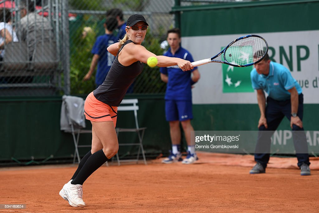<a gi-track='captionPersonalityLinkClicked' href=/galleries/search?phrase=Anastasia+Rodionova&family=editorial&specificpeople=5407492 ng-click='$event.stopPropagation()'>Anastasia Rodionova</a> of Australia plays a backhand during the Womens Double first round match against Timea Babos of Hungary and Yaroslave Shvedova of Kazakhstan at Roland Garros on May 25, 2016 in Paris, France.