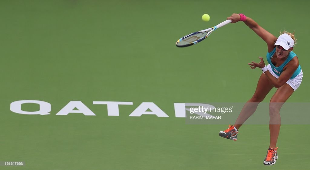 Anastasia Rodionova of Australia serves to Agnieszka Radwanska of Poland during their WTA Qatar Open tennis match on February 13, 2013 in the Qatari capital Doha.
