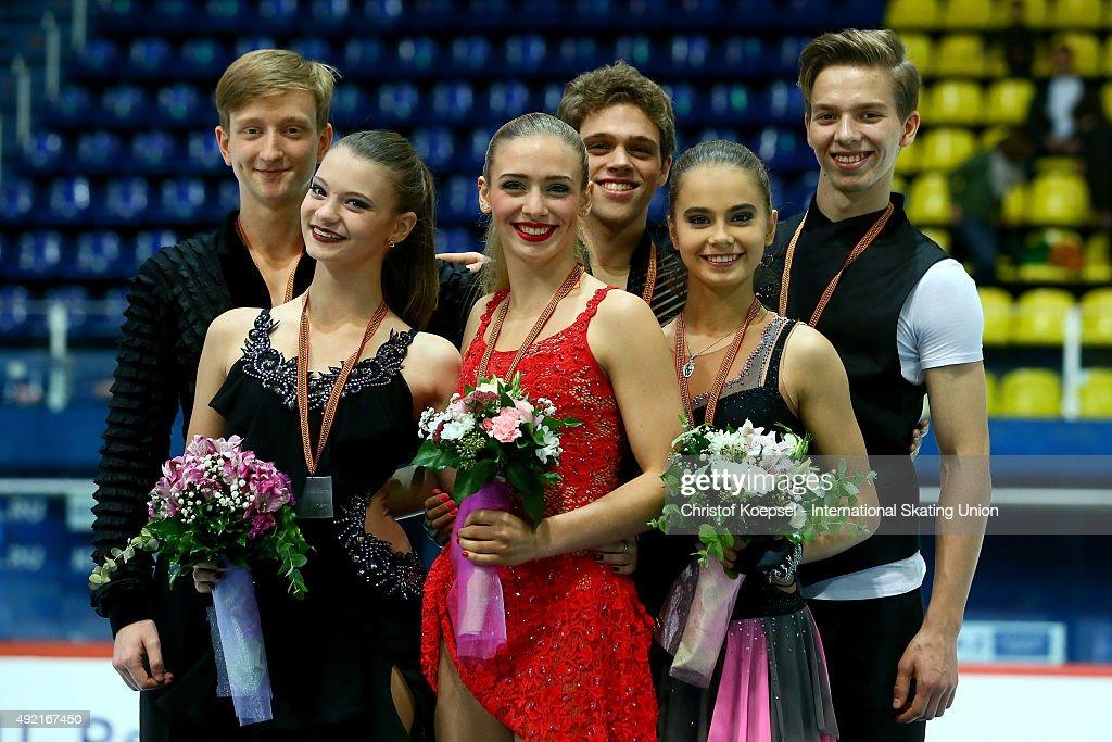 Anastasia Skoptcova and Kirill Aleshin of Russia present their silver medals Rachel Parsons and Michael Parsons of United States present their gold...