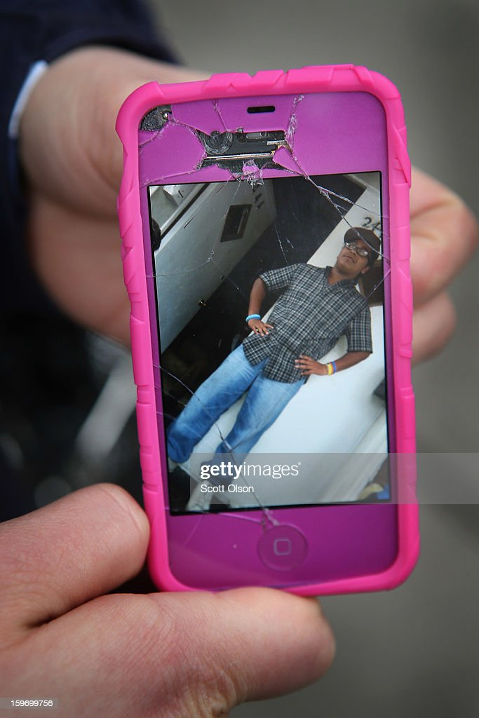 Anastasia Strope shows a picture of her stepbrother Rey Dorantes on her phone while standing outside her home on January 12, 2013 in Chicago, Illinois. Fourteen-year-old Dorantes died after being shot 6 times while sitting on the porch at the home the night before. Dorantes who was one of 6 teenagers shot in Chicago on January 11, became the 21st homicide in the city for 2013. In 2012 Chicago had more than 500 homicides.