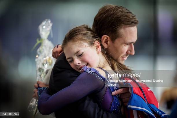 Anastasia Tarakanova of Russia is congratulated in the Junior Ladies Free Skating on day 3 of the ISU Junior Grand Prix of Figure Skating at Eis...