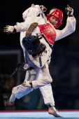 Anastasia Valueva of Russia competes against Fadia Farhani of Tunisia during the women's 46kg semifinals of WTF World Taekwondo Championships 2013 at...