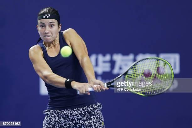 Anastasija Sevastova of Latvia hits a return against Julia Goerges of Germany during their women's singles semifinal match at the Zhuhai Elite Trophy...
