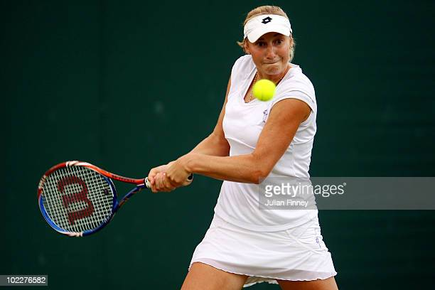 Anastasija Sevastova of Latvia in action during her first round match against Justine Henin of Belgium on Day One of the Wimbledon Lawn Tennis...