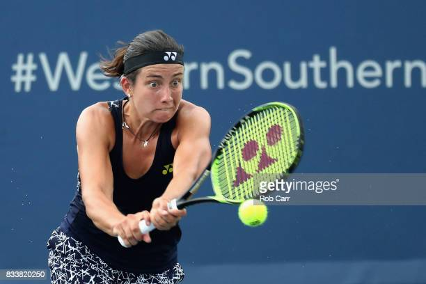 Anastasija Sevastova of Latvia returns a shot to Simona Halep of Romania during Day 6 of the Western and Southern Open at the Linder Family Tennis...