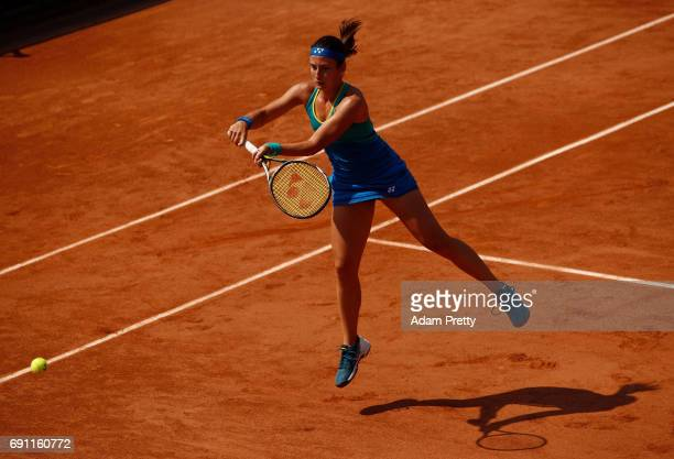 Anastasija Sevastova of Latvia volleys during the ladies singles second round match against Eugenie Bouchard of Canada on day five of the 2017 French...