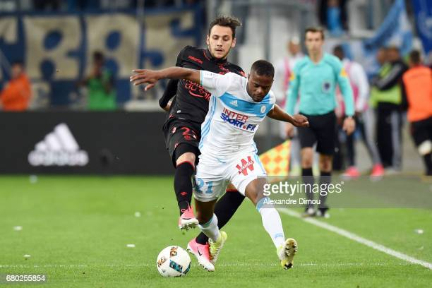 Anastasios Donis of Nice and Patrice Evra of Marseille during the Ligue 1 match between Olympique de Marseille and OGC Nice at Stade Velodrome on May...