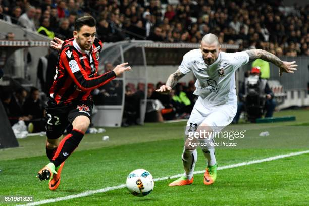 Anastasios Donis of Nice and Vincent Bessat of Caen during the Ligue 1 match between OGC Nice and SM Caen at Allianz Riviera on March 10 2017 in Nice...