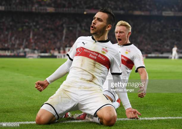 Anastasios Donis of Stuttgart celebrates with his teammate Andreas Beck of Stuttgart after scoring his team's first goal during the Bundesliga match...