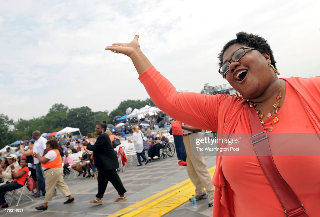 Anasuya Isaacs of Silver Spring MD sings along during the Let Freedom Ring 50th Anniversary Celebration on the National Mall that commemorates the...