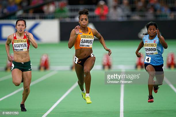 Anaszt¡zia Nguyen of Hungary Jamile Samuel of the Netherlands and Dutee Chand of India compete in the Women's 60 Metres Heats during day three of the...