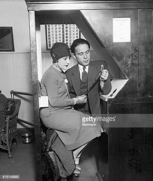 Anatol Josepho and his wife as they appeared seated at the Photomaton gazing at the strip of pictures taken with the machine that brought Josepho...