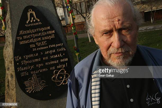 Anatoliy Koliadyn a former Chernobyl 'liquidator' stands for a photo next to a monument to the Chernobyl liquidators men who risked their lives to...
