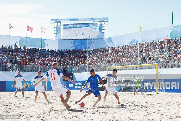 Anatoliy Peremitin and Kirill Romanov of Russia battle for the ball with Emmanuele Zurlo of Italy during the FIFA Beach Soccer World Cup 3rd place...