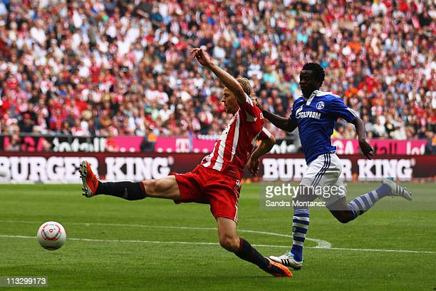 Anatoliy Tymoshchuk of Bayern is chased by Anthony Annan of Schalke during the Bundesliga match between FC Bayern Muenchen and FC Schalke 04 at...