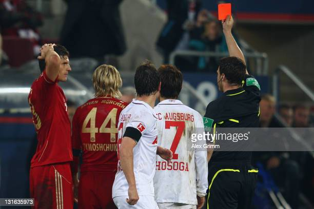 Anatoliy Tymoshchuk of Muenchen is sent oiff by referee Felix Zwayer during the Bundesliga match between FC Augsburg and FC Bayern Muenchen at SGL...