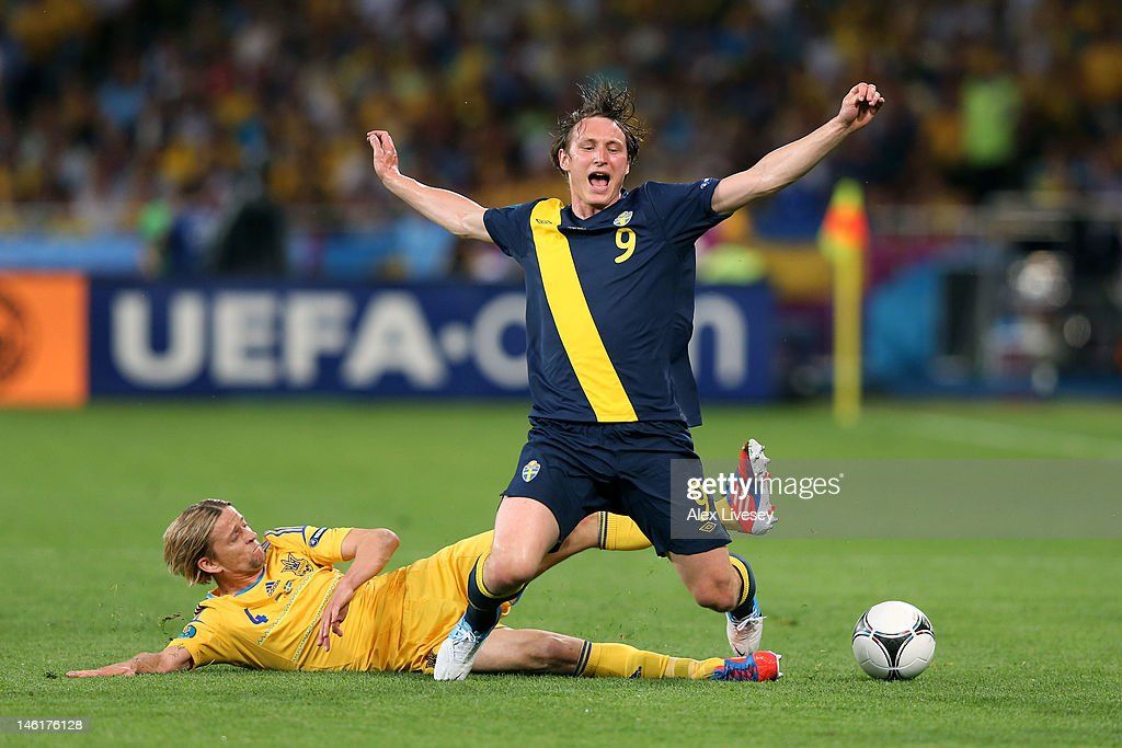 Anatoliy Tymoshchuk of Ukraine tackles <a gi-track='captionPersonalityLinkClicked' href=/galleries/search?phrase=Kim+Kallstrom&family=editorial&specificpeople=539780 ng-click='$event.stopPropagation()'>Kim Kallstrom</a> of Sweden during the UEFA EURO 2012 group D match between Ukraine and Sweden at The Olympic Stadium on June 11, 2012 in Kiev, Ukraine.