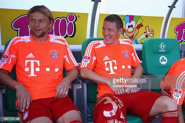 Anatoly Tymoshchuk and Bastian Schweinsteiger of Bayern sit on the bench during the Bundesliga match between Greuther Fuerth and FC Bayern Muenchen...