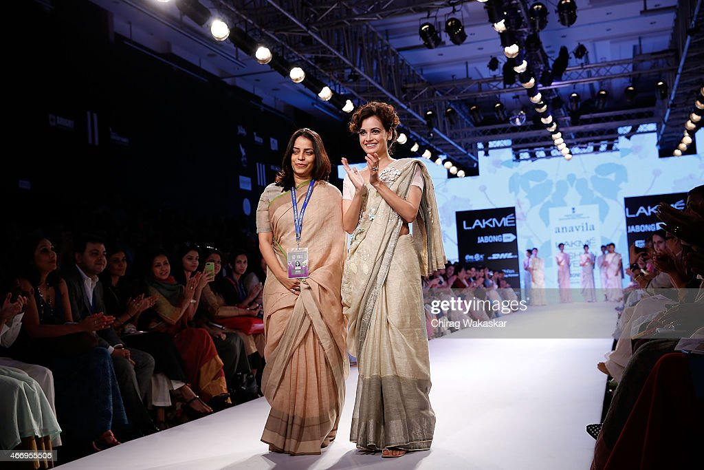 Anavila Misra and <a gi-track='captionPersonalityLinkClicked' href=/galleries/search?phrase=Dia+Mirza&family=editorial&specificpeople=696826 ng-click='$event.stopPropagation()'>Dia Mirza</a> walk the runway during the Anavila show on day 2 as part of Lakme Fashion Week Summer/Resort 2015 at Palladium Hotel on March 19, 2015 in Mumbai, India.