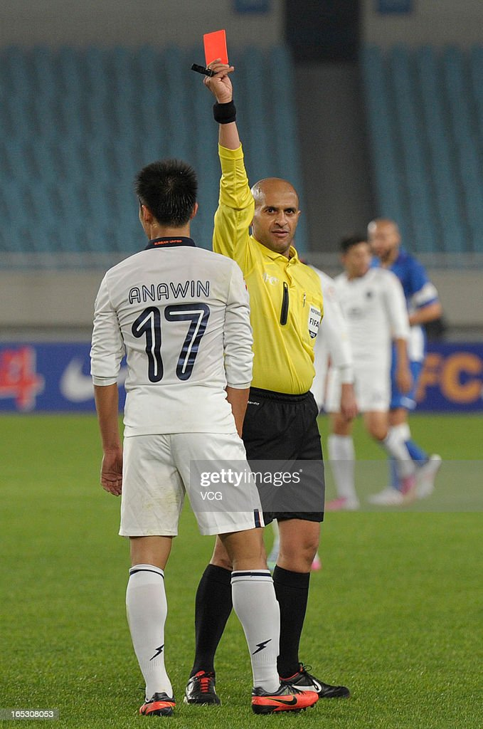 Anawin Jujeen #17 of Buriram United is shown the red card during the AFC Champions League match between Jiangsu Sainty and Buriram United at Nanjing Olympic Sports Center Stadium on April 2, 2013 in Nanjing, China.