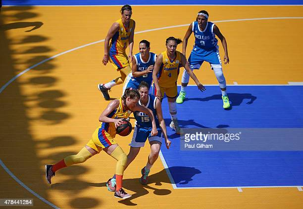 Anca Sipos of Romania takes the ball past Vasiliki Zuzana Karampatsa of Greece in the Women's 3x3 Basketball round of 16 knockout match between...