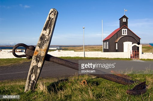 Anchor and church in Hafnir, Iceland : Stock Photo