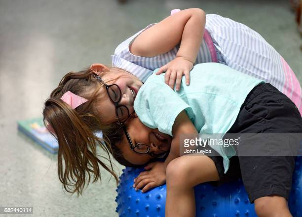 Anchor Center for Blind Children students Giovanni Ruvalcaba 5yearsold and Caroline Strickland 4yearsold have a little fun during an event at the...