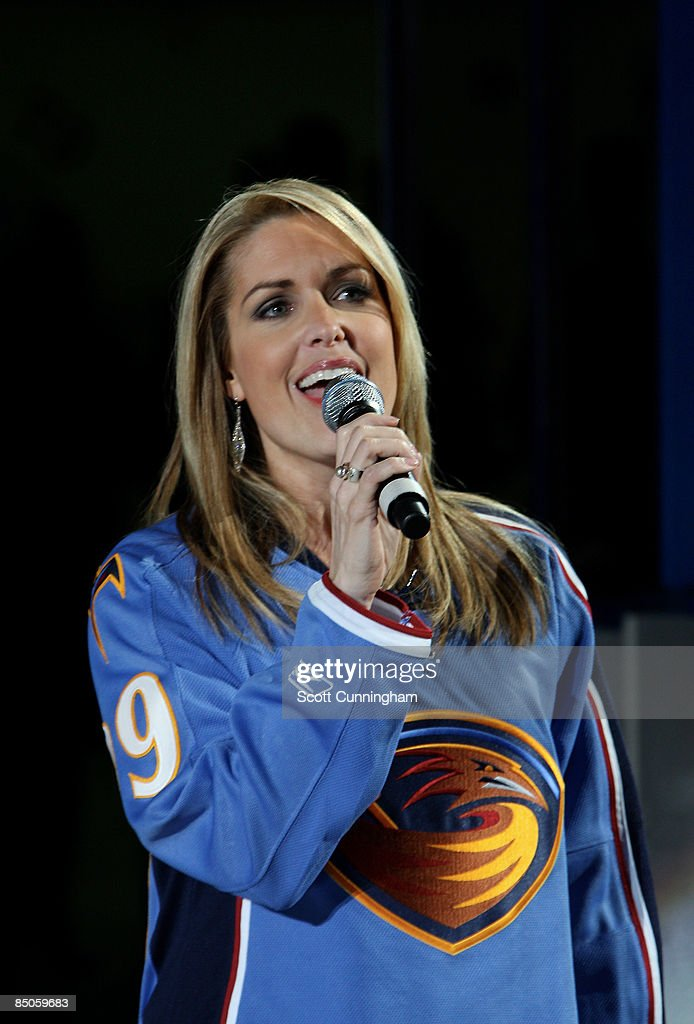 Anchor Christi Paul sings the National Anthem before the game against the Atlanta Thrashers and the Colorado Avalanche at Philips Arena on February...