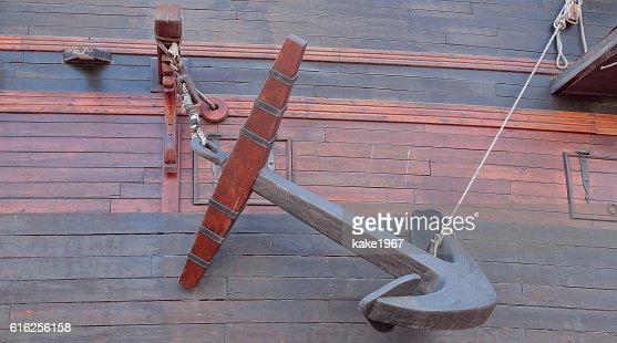 anchor in the hull of an ancient warship : Foto de stock