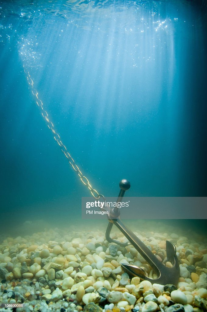 Anchor on ocean floor : Stock Photo