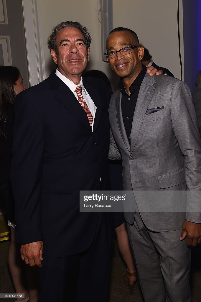 ESPN anchor Stuart Scott (R) attends the Paley Prize Gala honoring ESPN's 35th anniversary presented by Roc Nation Sports on May 28, 2014 in New York City.