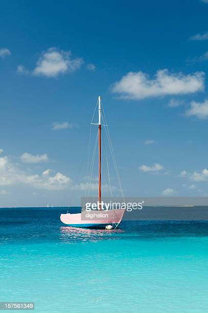 Anchoring pink boat in tropical bay