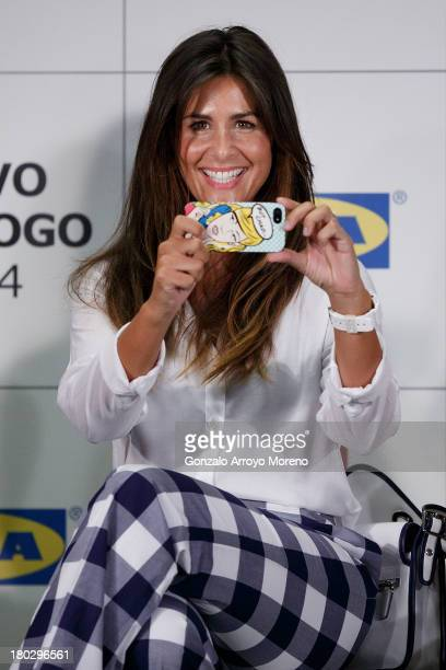 TV anchorwoman Nuria Roca takes a picture of the media with her smartphone at the Ikea Presentation at Ikea store on September 11 2013 in San...