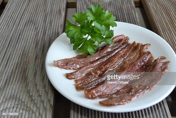 Anchovy fillets on a white plate