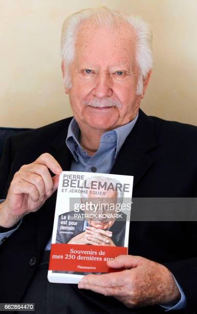 L'ancien animateur musicien producteur et auteur Pierre Bellemare pose avec son autobiographie intitulée 'Le bonheur est pour demain' le 25 octobre...