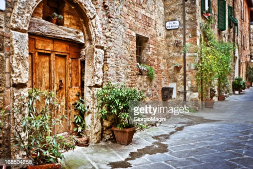Ancient Alley with Wooden Door in Tuscan Village, Val d'Orcia