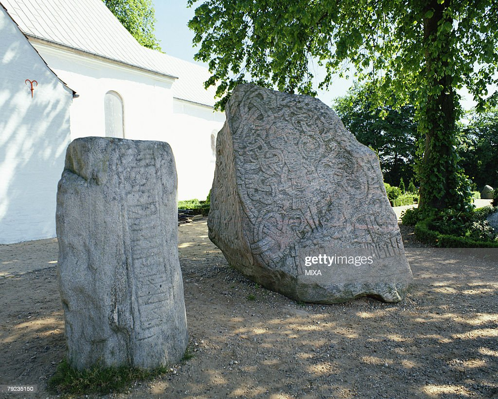 Ancient carvings on large rocks in Jelling Mounds, Denmark : Stock Photo